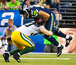 Seattle Seahawks tight end Luke Willson (82) is wrapped up by  Green Bay Packers line backer A.J. Hawk (50) after hauling in a Russell Wilson pass in the third quarter of the NFL Kickoff held at CenturyLink Field i September 4, 2014 in Seattle. Seattle beat Green Bay 36-16. ©2014  Jim Bryant Photo. ALL RIGHTS RESERVED.