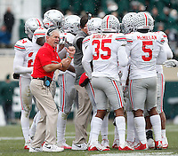 Ohio State assistant coach Kerry Coombs talks to his players in a huddle during Saturday's NCAA Division I football game at Spartan Stadium in East Lansing, Mich., on November19, 2016. Ohio State won the game 17-16. (Barbara J. Perenic/The Columbus Dispatch)