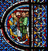 Jews witnessing the resurrection of Lazarus, from the Life of Mary Magdalene stained glass window, 13th century, in the nave of Chartres cathedral, Eure-et-Loir, France. Chartres cathedral was built 1194-1250 and is a fine example of Gothic architecture. Most of its windows date from 1205-40 although a few earlier 12th century examples are also intact. It was declared a UNESCO World Heritage Site in 1979. Picture by Manuel Cohen
