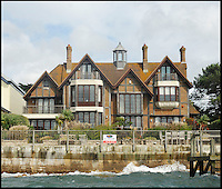 BNPS.co.uk (01202 558833)<br /> Pic: Lloyds/BNPS<br /> <br /> Harry Redknapp's Sandbanks home<br /> <br /> Humble origins of one of Britain's most exclusive addresses.<br /> <br /> A new book reveals how the millionaire's row of Sandbanks went from being a windswept wasteland to one of the most sought-after addresses in the world has been published. <br /> <br /> Today the harbour-front plots on the exclusive enclave in Poole, Dorset, are crammed with &pound;10m mansions and luxury flats while Ferraris and Bentleys parade its tree-lined streets.<br /> <br /> But you only have to go back the relatively short period of 100 years to see that Sandbanks - or Parkstone-on-Sea as it was known - was once a deserted landscape cut off from the rest of the country.