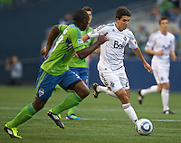Vancouver Whitecaps FC  forward Shea Salinas passes the ball during during play against the Seattle Sounders FC at Qwest Field in Seattle Saturday June 11, 2011. The game ended in a 2-2 draw.
