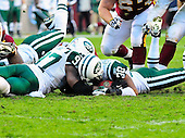 New York Jets linebacker Calvin Pace (97) and cornerback Donald Strickland (30) recover Washington Redskins quarterback Rex Grossman's fourth quarter fumble at FedEx Field in Landover, Maryland on Sunday, December 4, 2011.  The Jets won the game 34 - 19..Credit: Ron Sachs / CNP.(RESTRICTION: NO New York or New Jersey Newspapers or newspapers within a 75 mile radius of New York City)