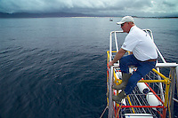 GANSBAAI, SOUTH AFRICA, DECEMBER 2004. Brian on the lookout for sharks. Brian Mc Farlane organises Great White Shark cage diving tours out of Gansbaai. Gansbaai is one of the best places in the world to see the Great white in its natural habitat. Photo by Frits Meyst/Adventure4ever.com