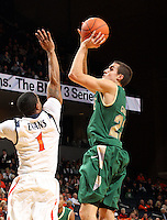 Nov. 12, 2010; Charlottesville, VA, USA;  William & Mary Tribe forward Kyle Gaillard (23) shoots over Virginia Cavaliers guard Jontel Evans (1) during the game at the John Paul Jones Arena.  Mandatory Credit: Andrew Shurtleff-