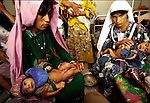 Women with their malnourished children on July 20. 1996 at the main hospital in Herat, Afghanistan. The Taliban took over most of Afghanistan in 1996, and have forced the people to live under strict muslim sharia law. Girls are not allowed to attend schools and women are not allowed to work. .(Photo: Per-Anders Pettersson  Kod/Liaison Agency)