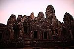 The ruins of Bayon, just after sunrise, at Angkor Thom, Cambodia. June 9, 2013.