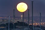 The first full moon of spring rose directly over Alcatraz Island as seen from Fort Baker in Sausalito California.