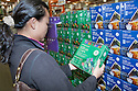 Mid adult woman shopping energy efficient LED holiday lights at Cosco. San Francisco, California, USA