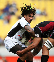 Wellington second five Ma'a Nonu tries to shrug off a tackle during the Air NZ Cup match between Wellington Lions and North Harbour at Westpac Stadium, Wellington, New Zealand on Saturday 17 October 2009. Photo: Dave Lintott / lintottphoto.co.nz.