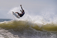 Surfing legend and ten time world champion Kelly Slater competes in the 2nd Heat of Round 4 of the 2011 Quiksilver Pro New York pro surfing contest.
