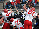 Sentinel/Dan Irving.GVSU quarterback Cullen Finnerty, center, passes against South Dakota Saturday afternoon at Lubbers Stadium in Allendale..(11/25/06)