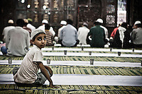Kashmri muslim kid waiting to break his fasting after praying at a shrine in Srinagar as the main duty to observe the holy month of Ramadan. As the tradition is attended muslims has to fast from dawn to dusk, where they refrain from eating, drinking and smoking.