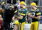 .Green Bay Packers' Matt Flynn and Aaron Rodgers play around before the start of Media Day. .Media Day for Super Bowl XXXXV was held Tuesday February 1, 2011 at Cowboy Stadium. Steve Apps-State Journal.