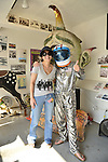 Brooklyn; New York; U.S. - August 9; 2014 - L-R, STACY VOURDERIS, co-founder of Coney Island History Project, and Space Cadet are next to Spook-A-Rama Cyclops at The Fourth Annual History Day at Deno's Wonder Wheel Amusement Park.