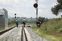 "Lecheria, MEX. 30 July 2014. Central American inmigrants wait for the train known as ""the beast"" in Lecheria , State of Mexico. Photo by Miguel Angel Pantaleon/VIEWpress"