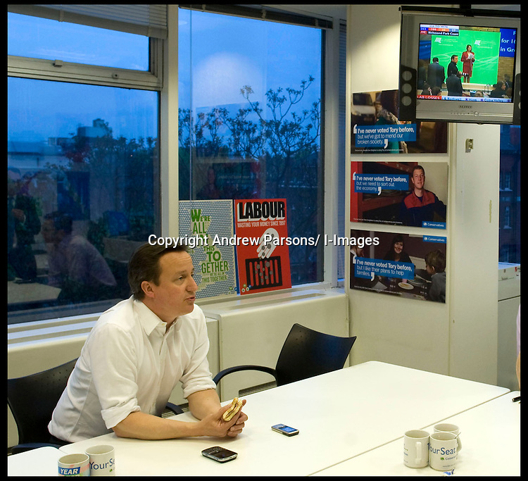 Leader of the Conservative Party David Cameron eats his breakfast in his office in CCHQ as he watches the election results come in in the early hours of Friday morning, Friday May 7, 2010. Photo By Andrew Parsons/i-Images.
