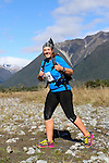NELSON LAKES, NEW ZEALAND - APRIL 18:  Fiona Rayner crosses the Travers River during the 2015 Alpine Lodge Loop The Lake trail run at Lake Rotoiti on April 18 16, 2015 in Nelson, New Zealand. (Photo by Marc Palmano/Shuttersport Limited)