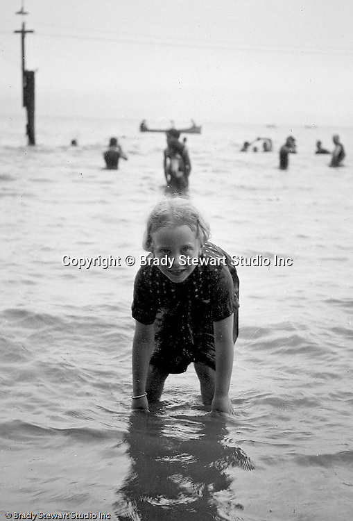 Lake Erie PA:  Little girl playing in the waves on Lake Erie - 1915.