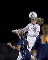 """Boston College midfielder Kate McCarthy (21) heads the ball. Boston College defeated West Virginia, 4-0, in NCAA tournament """"Sweet 16"""" match at Newton Soccer Field, Newton, MA."""