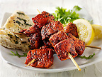Chicken Tikka with salad & naan bread.