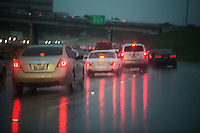 Rain soaked Mopac street with 5 p.m. rush hour traffic in Austin, Texas.