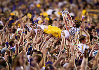 Oct 25, 2014; Baton Rouge, LA, USA; LSU Tigers wide receiver Trey Quinn (8) crowd surfs after fans stormed the field following the Tigers 10-7 victory agains the Mississippi Rebels at Tiger Stadium. Mandatory Credit: Crystal LoGiudice-USA TODAY Sports