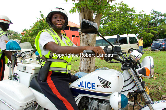 A Jamaican police woman acts as escort for Mrs Lorna Golding during filming of The Jamaica Tour for We TV