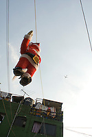 ***Embargoed for; SZ Magazin (Focus) Assignment number #1459, until x-mas 2008***.A Santa Clause pinata hanging over the street in a Mexico City neighborhood.  Mexico City. Monday, Dec. 17, 2007.****Germany, Switzerland and Austria Out****