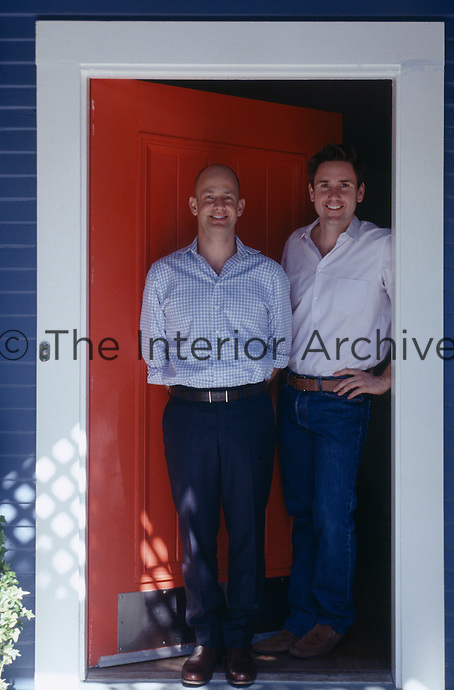 Designer Moises Esquenazi and his partner Bryan Graybill at the entrance of their Los Angeles home
