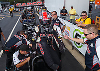 Sep 18, 2016; Concord, NC, USA; Crew members with NHRA top fuel driver Steve Torrence during the Carolina Nationals at zMax Dragway. Mandatory Credit: Mark J. Rebilas-USA TODAY Sports