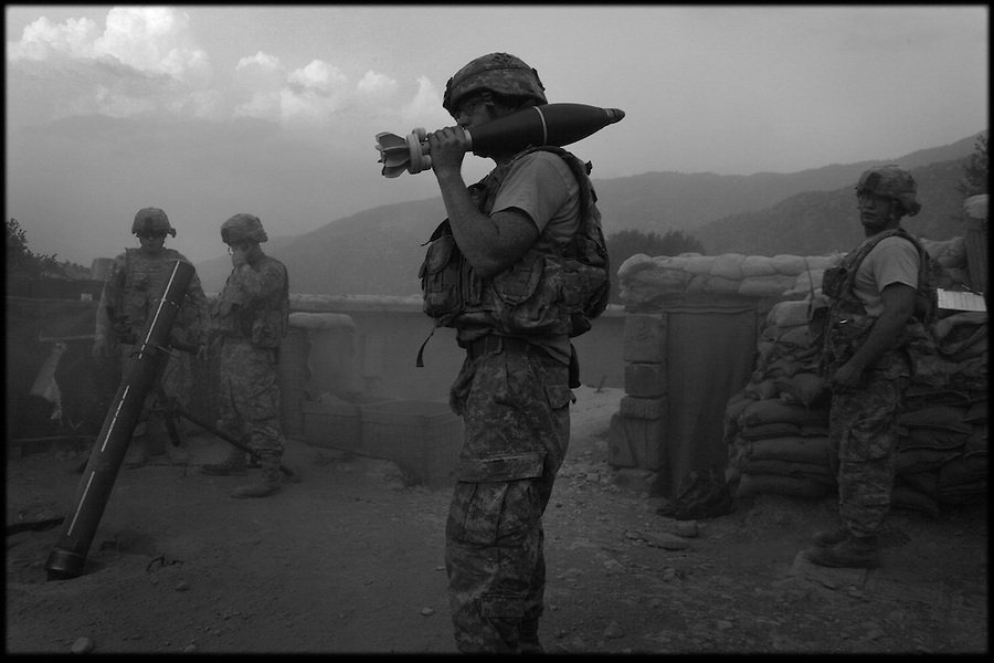 Mortar-men with Baker Co. 2-12 Infantry Regiment 4th Brigade 4th Infantry Division fire on Taliban fighters after one of the company's patrol bases came under attack in Afghanistan's Korengal Valley in the summer of 2009.