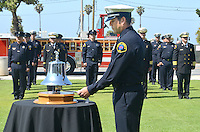Santa Monica Fire Captain Sean Van Sluis rings  the bell ten times during the Police/Fire Public Safety Memorial at City Hall on Wednesday, May 16, 2012. The memorial recognized public safety officers who gave their lives in the line of duty to protect the citizens of Santa Monica...