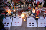Pictures of the slain officers, L to R) Tina Griswold, Ronald Owens, Mark Renninger and Greg Richards lie beneath candles,  flowers, balloons, stuff animals, pictures and wreaths that form a makeshift memorial to four slain police officers at the Police Headquarters in Lakewood, Washington, USA, on 2 December  2009. Four Lakewood officers were gunned down during a morning meeting at a local coffee shop on 29 November 2009. Jim Bryant Photo. ©2010. ALL RIGHTS RESERVED.