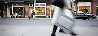 A shopper walks down spring street in Soho, New York