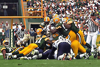 Led by Reggie White, the Green Bay Packers defense swarms over and sacks the San Diego Chargers quarterback as the Packers went on to defeat the Chargers 42-10 on September 15, 1996. The Packers had the number one rated defense in the league in 1996-97.