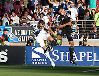 Jason Hernandez of Earthquakes fights for the ball in the air against Landon Donovan of Galaxy during the game at Stanford Stadium in Palo Alto, California on June 30th, 2012.  San Jose Earthquakes defeated LA Galaxy, 4-3.