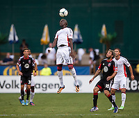 Saer Sene (39) of the New England Revolution goes up for a header  during a Major League Soccer game at RFK Stadium in Washington, DC.  New England defeated D.C. United, 2-1.