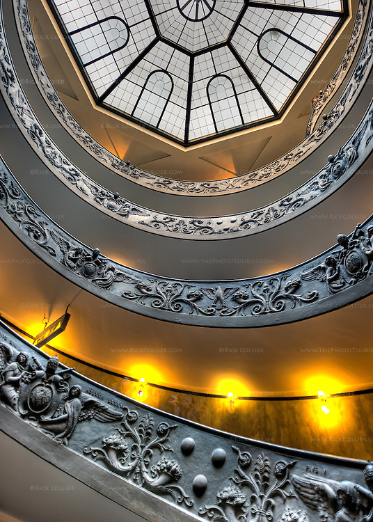 The famous spiral steps are just as impressive and beautiful looking up from the floor at the bottom.  (HDR image in the Vatican Museum)