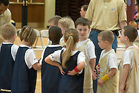 young boys & girls await turn to play in a church league basketball game, Richmond, VA, USA