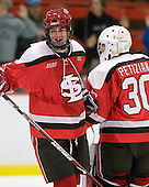 George Hughes (St. Lawrence - 15), Alex Petizian (St. Lawrence - 30) - The St. Lawrence University Saints defeated the Harvard University Crimson 3-2 on Friday, November 20, 2009, at the Bright Hockey Center in Cambridge, Massachusetts.