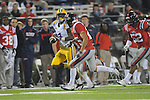 LSU running back Alfred Blue (4) is chased by Ole Miss' Cody Prewitt (25) at Vaught-Hemingway Stadium in Oxford, Miss. on Saturday, November 19, 2011. (AP Photo/Oxford Eagle, Bruce Newman).