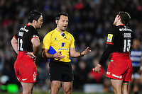 Referee Greg Garner has a word with Brad Barritt and Alex Goode of Saracens. Aviva Premiership match, between Bath Rugby and Saracens on April 1, 2016 at the Recreation Ground in Bath, England. Photo by: Patrick Khachfe / Onside Images