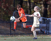 University of Miami forward Kate Howarth (1) crosses the ball as Boston College midfielder Lauren Bernard (5) defends..After two overtime periods, Boston College (gold) tied University of Miami (orange), 0-0, at Newton Campus Field, October 21, 2012.