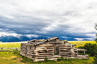 "Stormy day at the Shane Cabin of the movie ""Shane"" fame.  The Grand Tetons of Jackson Hole are the mountains in the distance.  Grand Teton National Park"