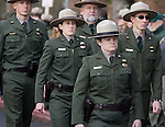 National Park Service Rangers walk behind the hearse carrying the casket of National Park Service Ranger Margaret Anderson  during a memorial service at the Pacific Lutheran University in Tacoma on January 10, 2010. Anderson was slain at Mount Rainier on New Years' Day when she set up a road block to intercept a vehicle, driven by Benjamin Barnes, who failed to stop at a chain-up checkpoint.  Barnes, the suspect  in the shooting was found dead was found dead the next day. He had drown in Paradise Creek.   ©2012. Jim Bryant Photo. All RIGHTS RESERVED.