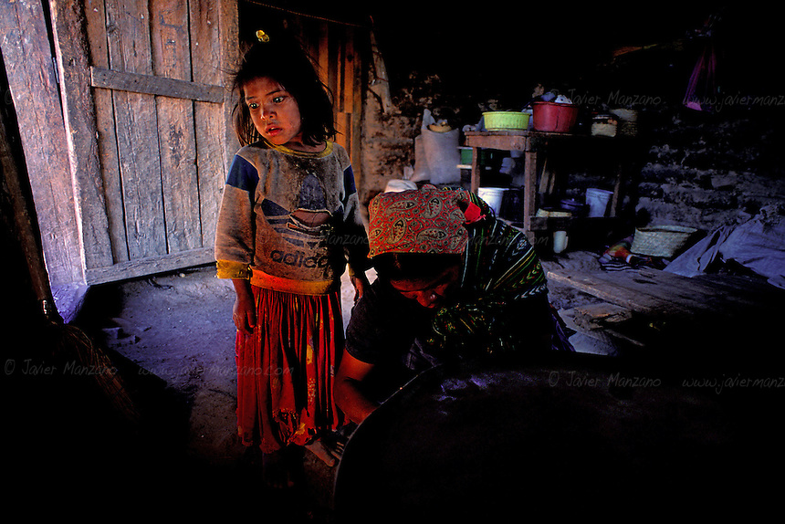 Matilde Ramirez Garcia, age 3, spends her days with her mother, Aniceta Garcia Siria de Leon, as she learns the gender roles she will one day have to play, in the highly patriarchal society of the Tarahumara Indians. Rekowata, Chihuahua Mexico. 04/29/04.
