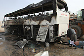 NAJAFA, IRAQ: A bus damaged in a car bomb....A car bomb in Iraq's holy city of Najaf has killed at least three people and wounded 50 on the eve of tense parliamentary elections