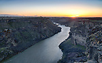 Idaho, South central, Twin Falls. Sunset over the Snake River Canyon in spring.