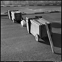Garbage cans are used to block a road on the Jewish Sabbath, Jerusalem, 1997 as part of  acampaign by the fundamentalist Orthodox Jews to force non-orthodox and religious Jews to obey the Sabbath laws.  .Part of SCARS series. Photo Greg Marinovich / South