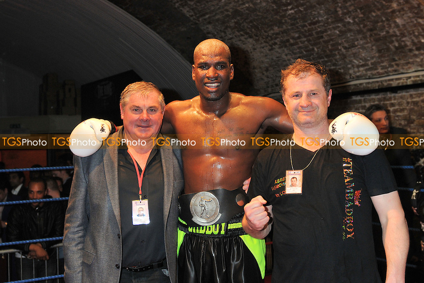 Lawrence Bennett (black shorts) with manager Keith Mayo (L) after he defeats Jack Morris in a boxing contest at The Ring, London - 27/03/14 - MANDATORY CREDIT: Philip Sharkey/TGSPHOTO - Self billing applies where appropriate - 0845 094 6026 - contact@tgsphoto.co.uk - NO UNPAID USE